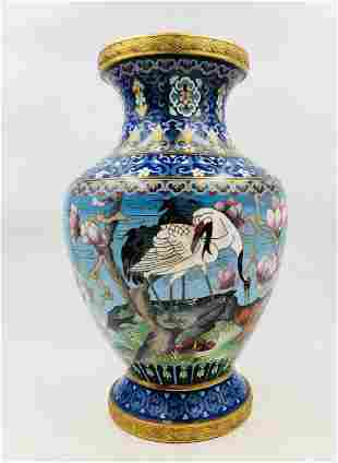 A CHINESE BLUE GROUND CRANES-AND-FLOWERS CLOISONNE VASE