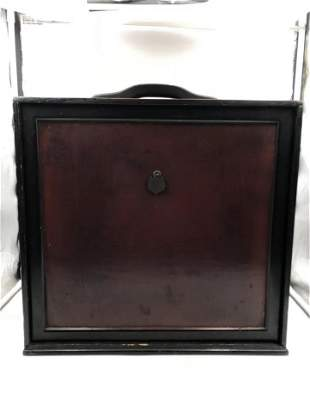 A CHINESE LACQUERED BOOK BOX WITH LOOP HANDLE