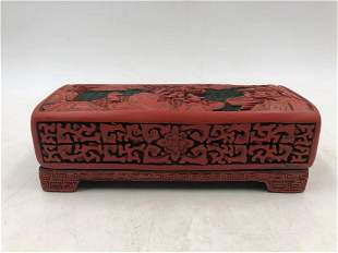 A CHINESE CARVED LACQUER RECTANGULAR BOX AND COVER