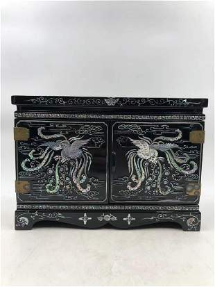 A CHINESE LACQUER INLAID MOTHER OF PEARL CABINET