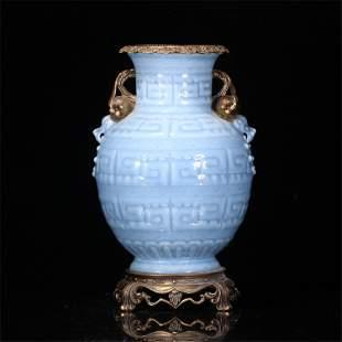 A CHINESE CELADON GLAZED PORCELAIN DOUBLE HANDLE VASE