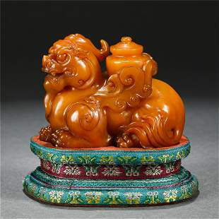 A CHINESE SOAP STONE FOO-DOG ORNAMENTS