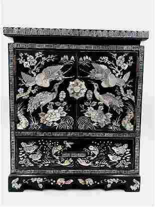 A MOTHER-OF-PEARL INLAID LACQUER-WARE JEWELLERY CABINET