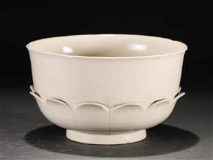 A CHINESE WHITE GLAZED LOTUS SHAPED PORCELAIN BOWL