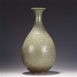 A CHINESE LONGQUAN TYPE INCISED PORCELAIN VASE