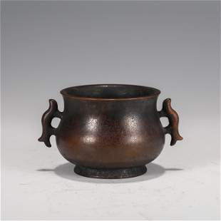 A CHINESE BRONZE INCENSE BURNER WITH DOUBLE HANDLES