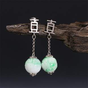A PAIR OF CHINESE JADEITE EAR DROPS