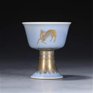 A CHINESE BLUE GLAZE GOLD-PAINTED PORCELAIN STEM CUP