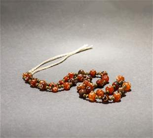 A STRING OF WESTERN ASIA BEADS