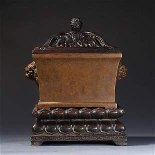 A CHINESE SQUARE BRONZE CENSER WITH LION HANDLES