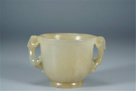 A CHINESE JADE CUP WITH CHI-DRAGON HANDLES