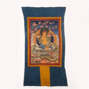 A CHINESE EMBROIDERY THANGKA OF BUDDHA