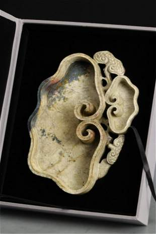 A CHINESE RUYI SHAPED JADE BRUSH WASHER