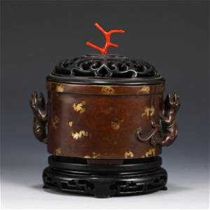 A CHINESE DOUBLE-HANDLED BRONZE CENSER