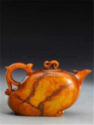 A CHINESE CARVED SOAPSTONE TEA POT