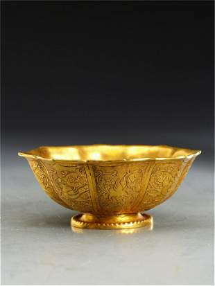 A CHINESE CARVED PHOENIXES BRONZE GILT BOWL