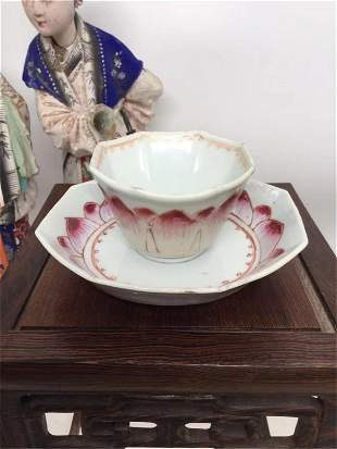 A FAMILLE ROSE LOTUS TEA CUP AND SAUCER