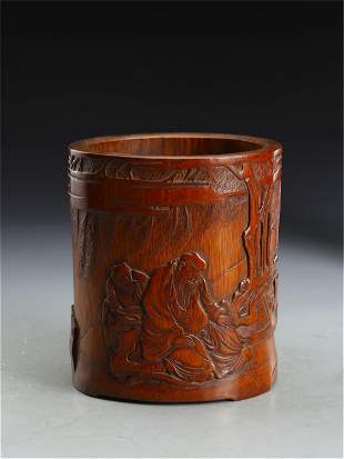 A CHINESE CARVED BAMBOO FIGURAL BRUSH-POT