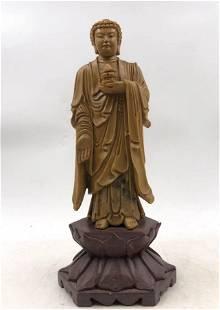 A STONE CARVED BUDDHA STATUETTE