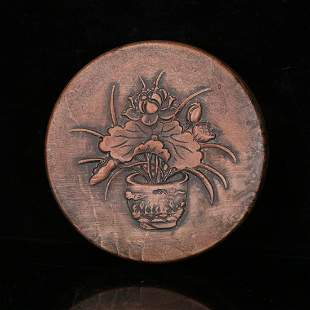 A CIRCULAR INK-STONE WITH CARVED LOTUS