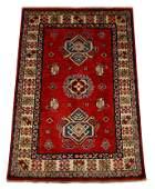 "RUG: Uzbek Kazak, 3' 11"" x 4' 5"", wool on cotton, red"