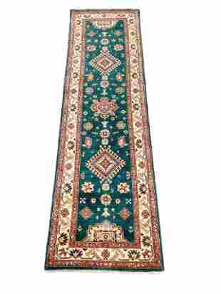 "RUG: Uzbek Kazak, 2' 8"" x 9' 6"", emerald field with"
