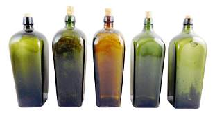 Four dark olive green and one amber case gin bottles,