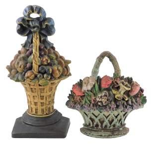 Hubley, etc., two large cast iron floral basket