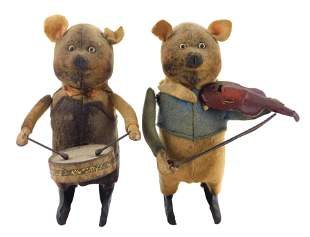 TOYS: Two early Disney wind-up pigs by Schuco, Germany,