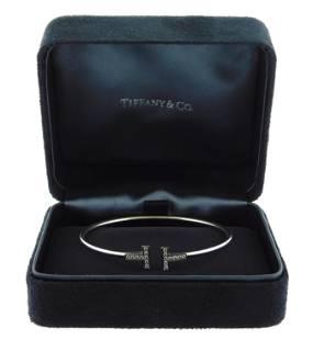 """JEWELRY: 18K Tiffany & Co. Diamond """"T"""" bracelet, wire"""