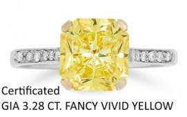 IMPORTANT 3.28 FANCY VIVID YELLOW DIAMOND RING.