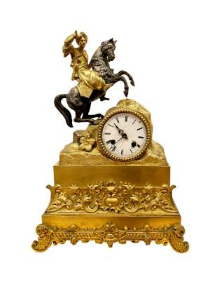 A 19th century French gilt bronze clock depicting an