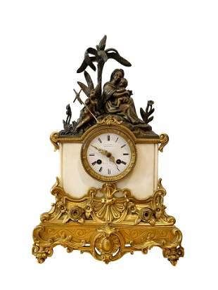 A 19th century French bronze mantel clock, white enamel