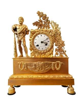 A circa 1830 French Empire gilt bronze clock depicting