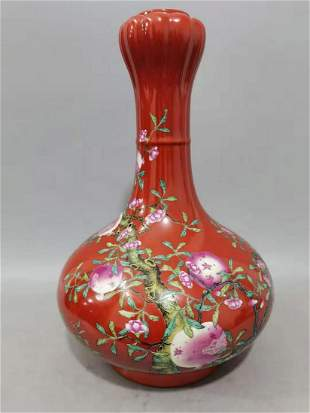 A CORAL RED GARLIC-HEAD-SHAPED BOTTLE