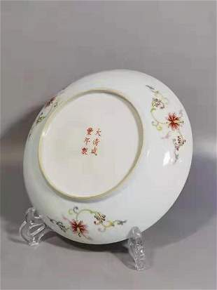 A QING DYNASTY XIAN FENG FAMILLE ROSE DRAGON PLATE