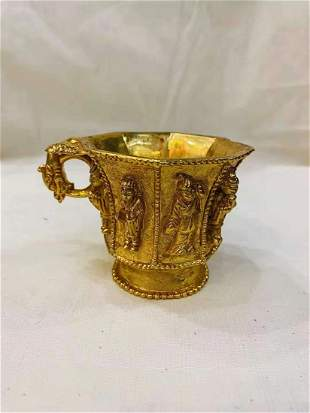 A TANG DYNASTY BRONZE GILDED GOLD FIGURE CUP