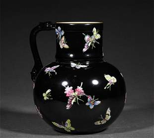 A QING DYNASTY FAMILLE ROSE BLACK GROUND BUTTERFLY