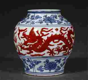 A MING DYNASTY BLUE AND WHITE IRON-RED DRAON GRAIN JAR
