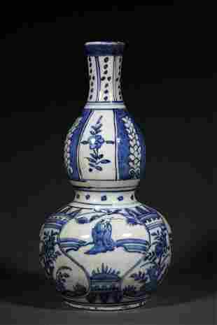 A MING DYNASTY BLUE AND WHITE FIGURE GOURD BOTTLE