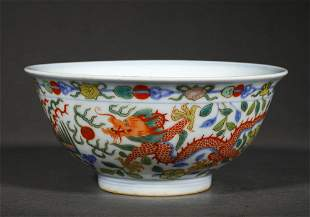 A QING DYNASTY BLUE AND WHITE DRAGON GRAIN BOWL