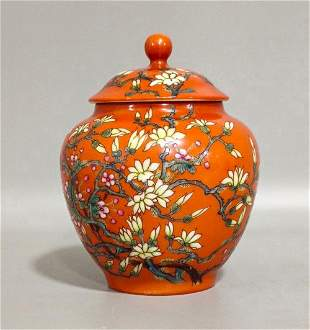 A QING DYNASTY FAMILLE ROSE CORAL RED GROUND ORCHID