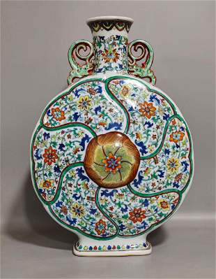 A QING DYNASTY CLASHING COLOR FLOWER MOON FLASKS
