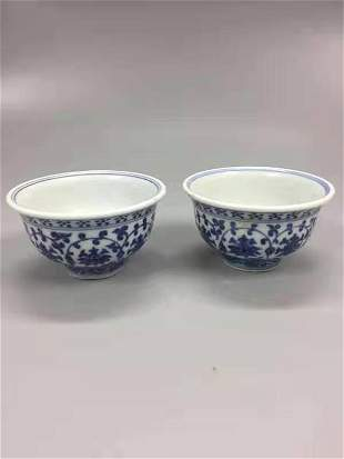 A PAIR OF MING DYNASTY YONGLE BLACK AND WHITE CUPS