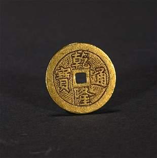 A QING DYNASTY QIANLONG TONGBAO GOLD COIN