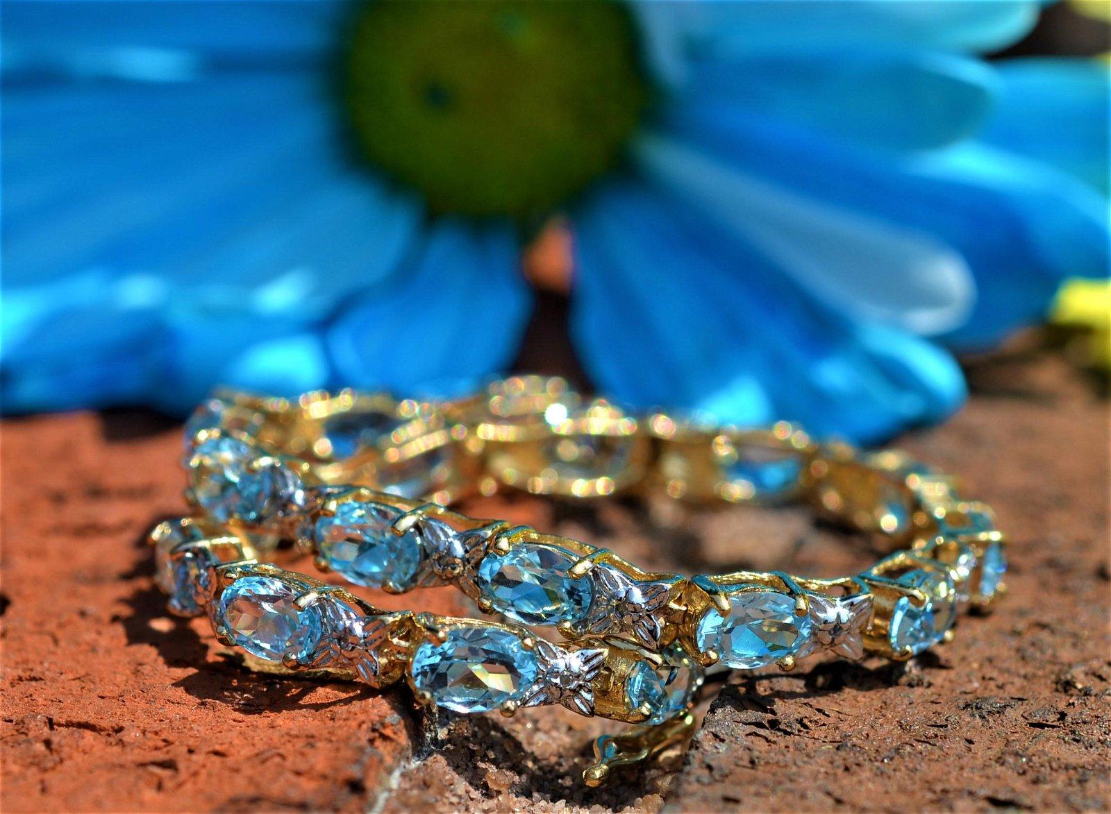 Sparkling Blue Topaz and Diamond Tennis Bracelet