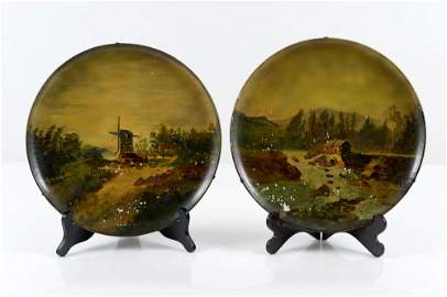 Pair of ceramic p lates painted with landscapes Italian