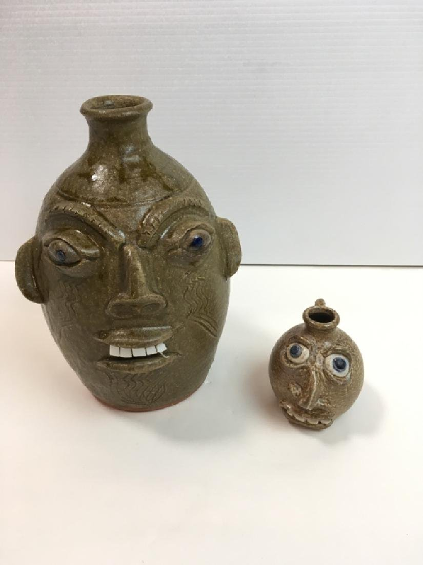 2 NC POTTERY FACE JUGS - SIGNED