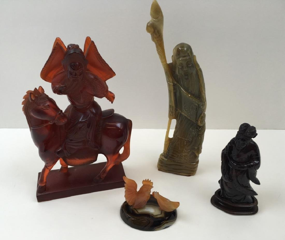 4 PCS OF CARVED STONE & RESIN FIGURES