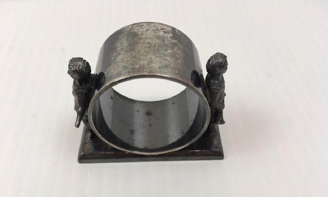 3 ANTIQUE SILVER PLATE NAPKIN RINGS - 10